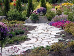 Landscaping service designs a beautiful garden path in a home garden