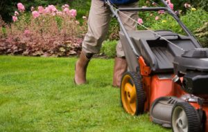 Professional lawn care services mowing a residential lawn properly